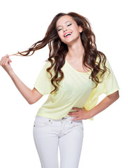 Young happy expressive woman with long brown hair