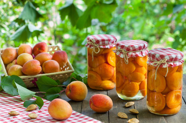 Jars with apricot and apricot fruit