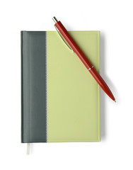Notebook and silver pen on white background with clipping path