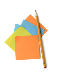 Adhesive notes and pencil isolated on white background with clip