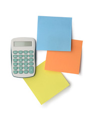 Calculator and sticky notes isolated on white background with cl