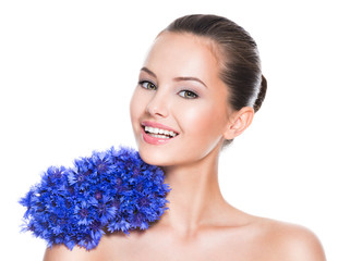Beautiful smiling woman with blue wildflowers.
