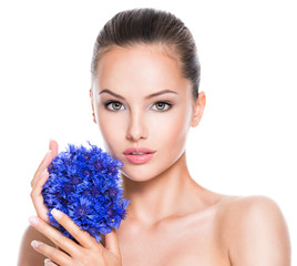 Face of a beautiful girl  with blue posy fild flowers.