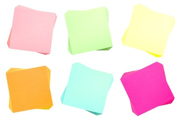 Six pads of blank sticky notes of various colors