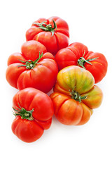 fresh tomatoes over white background.