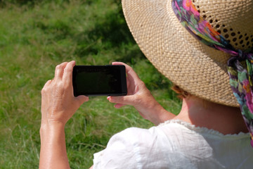 Senior 65 year old woman with mobile phone.