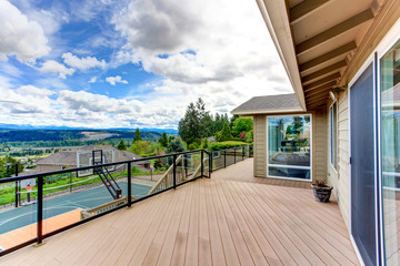 Walkout deck with backyard view