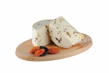 Cheese with prunes and dried apricots isolated on white