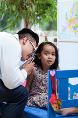 Asian pediatrician during medical appointment