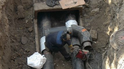 Welding pipe, welder left