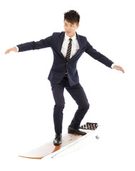 businessman practice surfing pose with suit