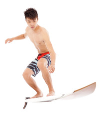 professional young surfer practice surfing pose