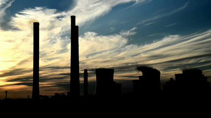 silhouette of power station, time lapse