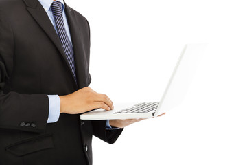 close up of businessman using laptop in hand