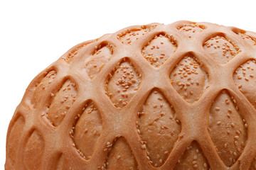 Wheat bread with sesame and pattern. Isolated on white closeup
