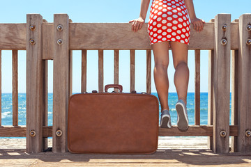 woman with vintage suitcase