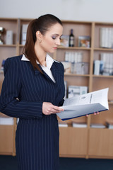 Businesswoman read catalog