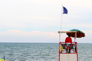 High tower with lifeguards during the choppy sea in summer
