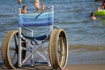 wheelchair with steel wheels to enter the sea for people with di
