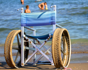 wheelchair with perforated wheels on the Sea Beach