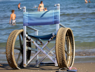 wheelchair with perforated wheels for swimming in the sea of peo