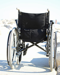 black wheelchair from behind with rubber wheels