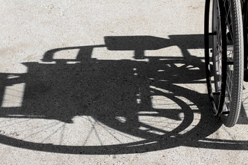 shadow of the wheelchair and the tyre