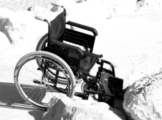 wheelchair stuck on the rocks by the sea 1