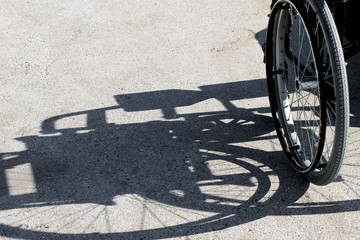 shadow of the wheelchair and the detail of the tyre