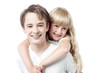 Young boy giving little girl piggyback ride