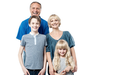 Cheerful family of four studio portrait
