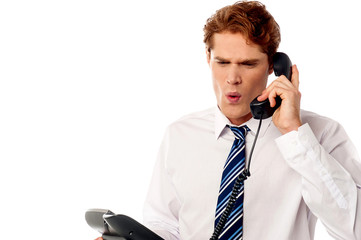 Frustrated business executive shouting