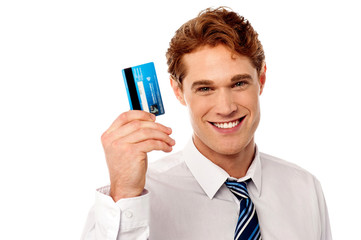 Smiling corporate guy holding credit card
