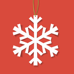 Paper snowflake on red background