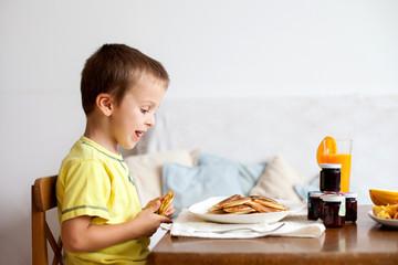 Cute boy, eating pancakes