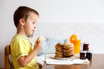 Cute boy, eating pancakes