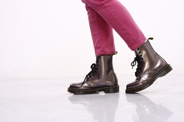 pink pants and leather boots