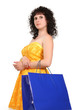brunette in a yellow dress with shopping bags