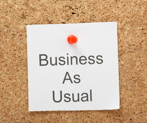 Business as Usual reminder on a cork notice board