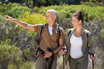 Happy hiking couple standing looking at something