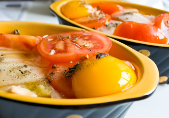 Raw eggs with tomatoes.
