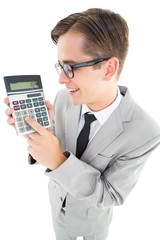 Geeky smiling businessman showing calculator