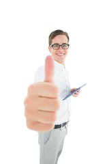 Geeky businessman holding his tablet showing thumbs up
