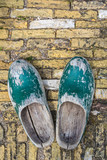 Old Dutch clogs on a brick background