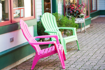 Pink and Green Chairs on Town Sidewalk