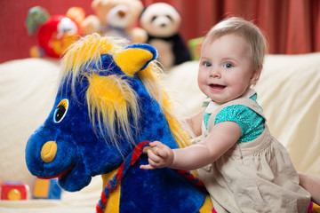 10 months old baby girl riding rocking horse