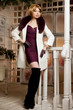 Beautiful adult woman in  winter coat with fur. Trendy modern bl