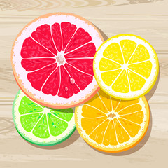 Four slices of citrus fruits on a wooden background