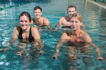 Fitness class using underwater exercise bikes