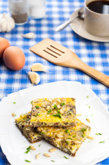 Delicious omlette with sardines and pine seeds